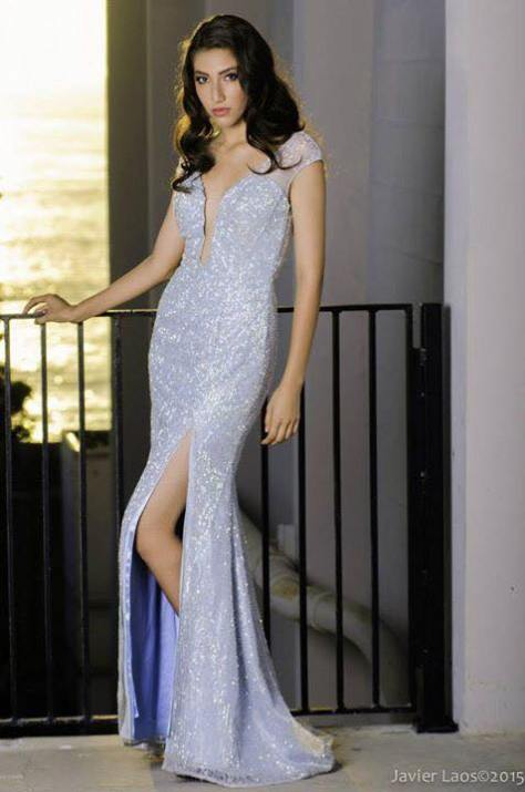 Hair and makeup for this pageant contestant by Badri and her gown is by Claire's Collections