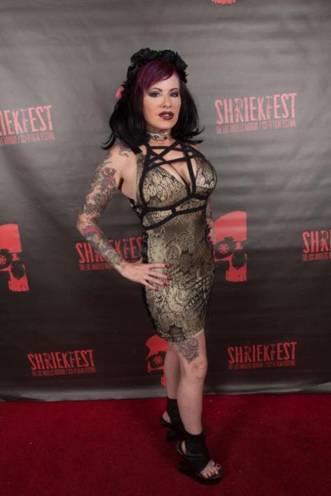 TV host JosiKat strikes a pose on the red carpet