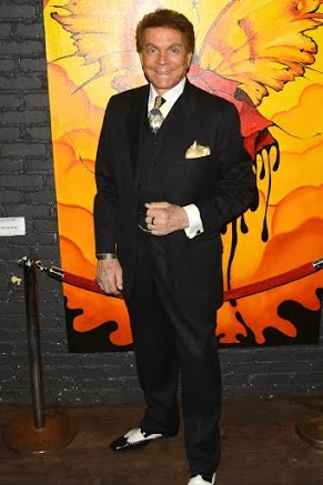 Actor Mel Novak looks sharp in his suit from Rocky's Custom Clothes. Photo courtesy of Billy Bennight/PR Photos