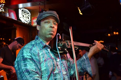 Lionel Young on electric violin. Photo courtesy the Hollywood Press Corps