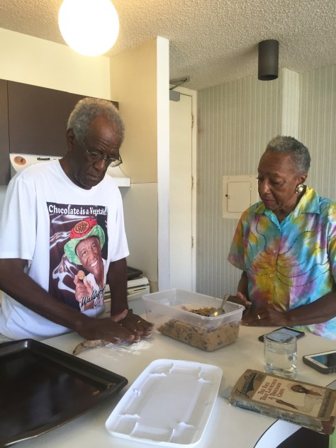 Wally and Carol Amos rolling cookies together