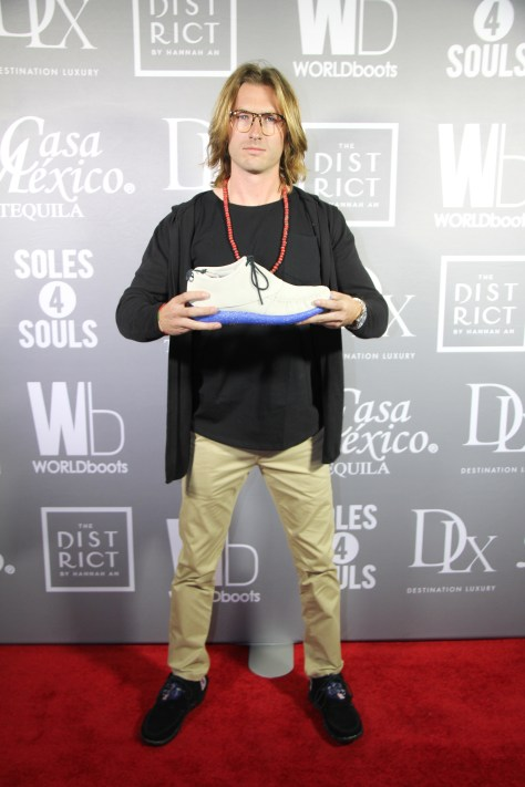Designer Ben Zerbe on the red carpet at the Workdboots launch supporting Souls for Soles Charity