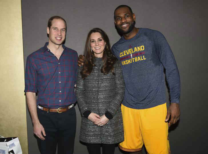 Catherine Duchess of Cambridge and Prince William with Lebron James at the Brooklyn Nets vs. Cleveland Cavaliers, NBA Basketball game on Dec. 8, 2014 in New York.
