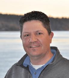 Andrew D. Holman, PLS and President of Holman Land Surveying, Inc.