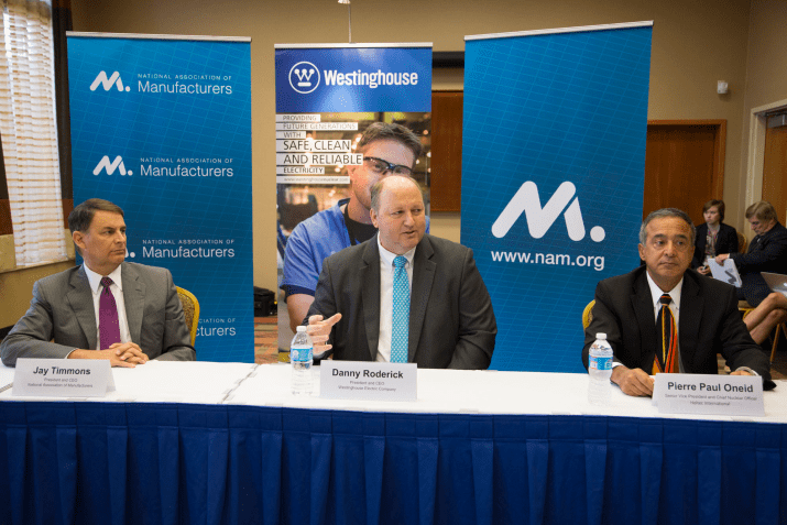 Jay Timmons (National Association of Manufacturers), Danny Roderick (Westinghouse Electric Company), and Pierre Oneid (Holtec International) urge Congress to reauthorize the U.S. Export-Import Bank. Photo by Ian Wagreich.