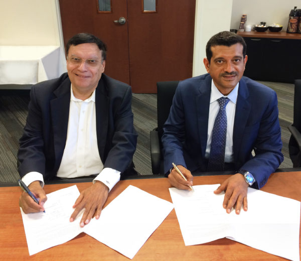 Dr. Kris Singh (Left) and Dr. Saeed Almutawa (Right) Sign the Joint Venture Agreement During the Holtec Advisory Council Meeting on August 3, 2016