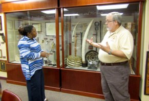 Dana shares information with Sharon on exhibit design.
