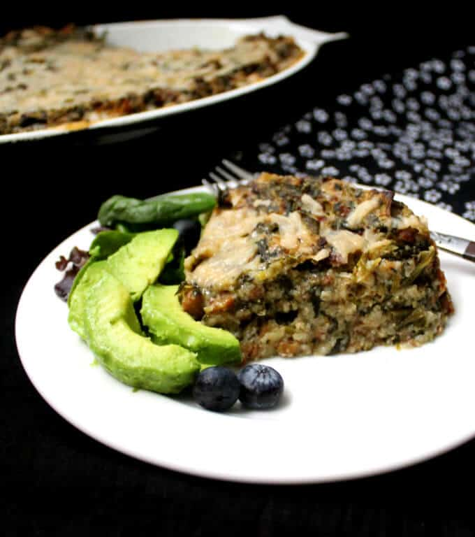 A Vegan Sausage and Grits Quiche is good eats for breakfast, brunch, lunch or dinner. Packed with protein from the vegan sausage, with leeks and spinach infused in every bite, this delicious take on a southern classic will make you want to eat until every last bit is happily tucked away in your tummy. #vegan #southernvegan #quiche #casserole #onepot #breakfast #brunch #lunch #dinner #thanksgivingbreakfast HolyCowVegan.net