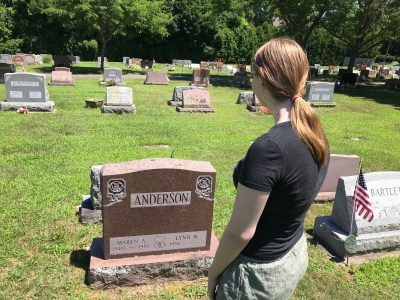 Rebekah Anderson standing at the grave of her grandmother.