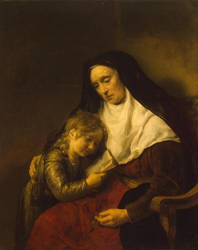 A boy around eight years old leaning into an older woman, dressed like a nun.