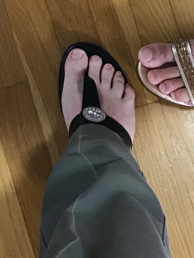 Pastor Eric's foot in a high-heeled shoe.