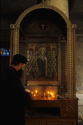 Photo: Norbert Schiller, a preist lights a candle before the icon of Saint Dimyana near Bilqas.