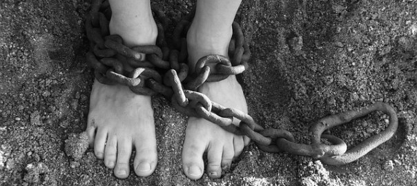 victim of oppression, feet in bondage