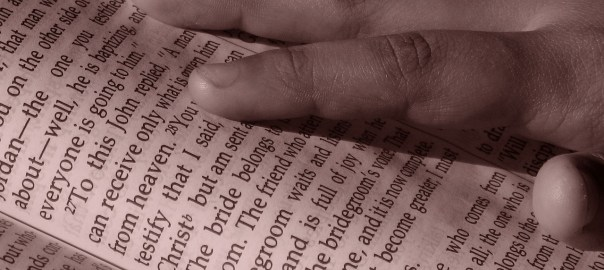 grace, works, mercy, picture of hand on the Bible