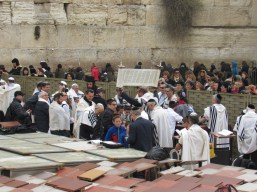 Bar Mitzvah at the Western Wall...notice the women family members on the other side of the wall looking in, as is the custom.