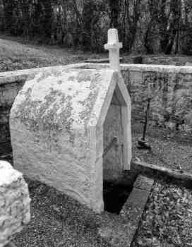 Whitewashed wellhouse