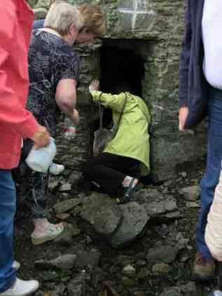 Taking the water after Mass, St John's Well, Carrigaline