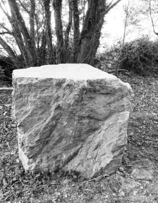 A huge block of stone just outside the walled well