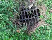 A grill hints at water below