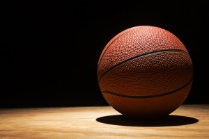 basketball on the hardwood in a spotlight