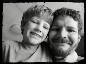 boy and dad big smiles