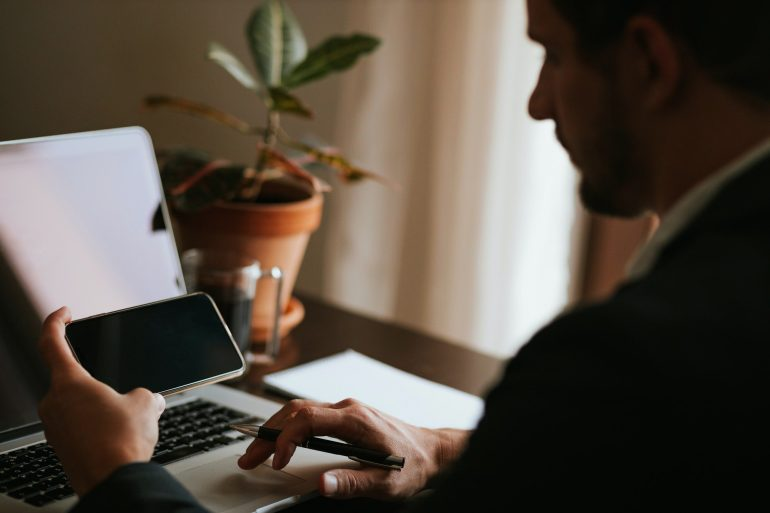 office worker browsing phone copy space