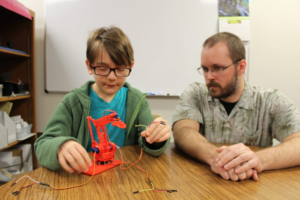 A gifted mentor works with a gifted student on a robotics project