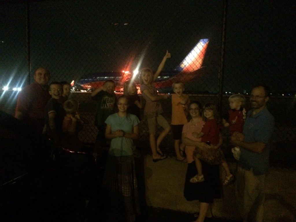 The Pickup Crew in front of a Southwest plane at the ATL Cell Phone Lot, a perfect place to watch airplanes.