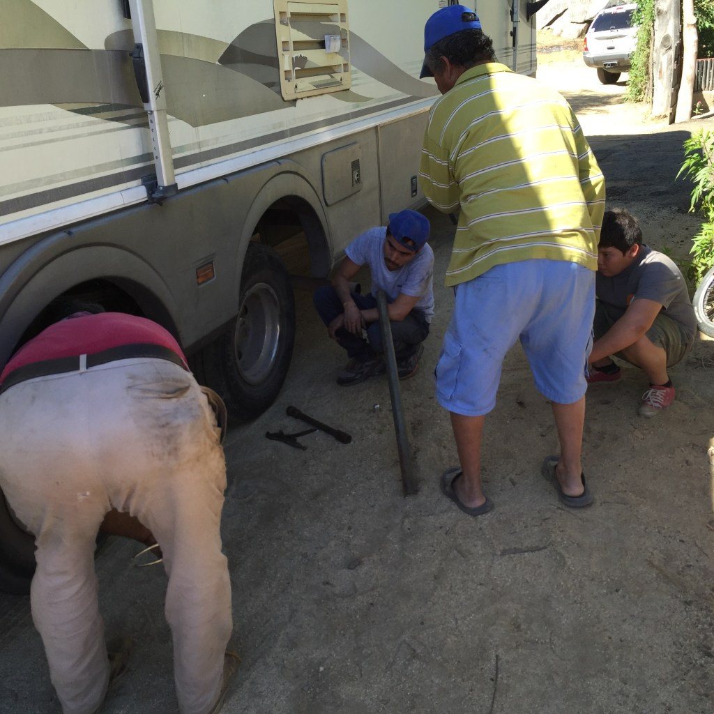 How many guys does it take to change a tire?