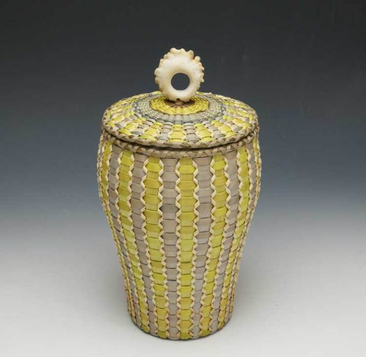 Sarah Sockbeson vase form basket with green and grey dyes