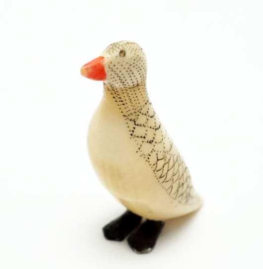 Vintage ivory scrimshaw bird