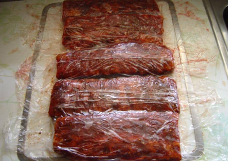 Cover Ribs with cellophane for a couple of hours