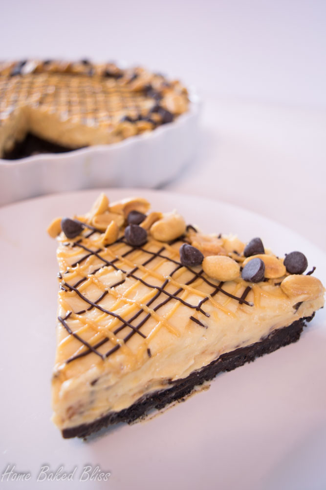 A slice of peanut butter chocolate pie on a white plate.