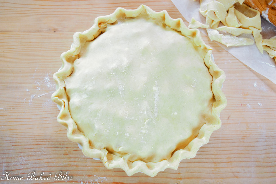 A gluten free pie with crimped edges.