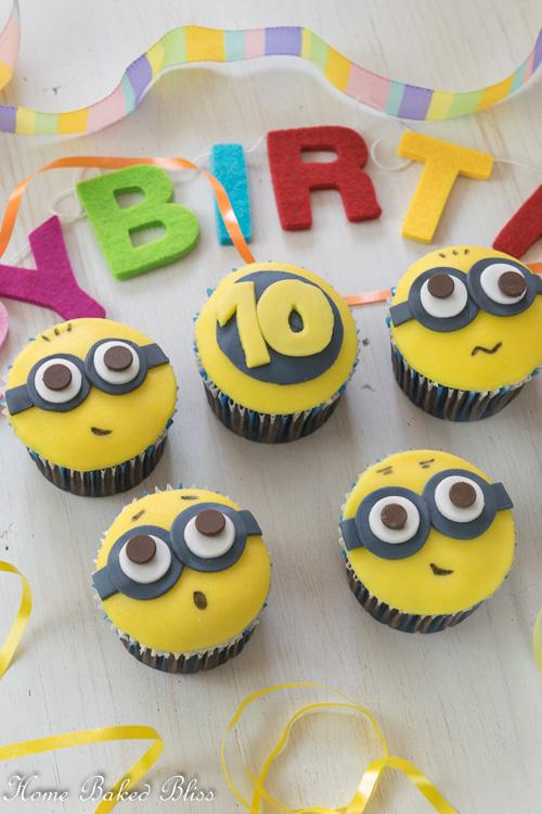 Minion Cupcakes beside a birthday banner.