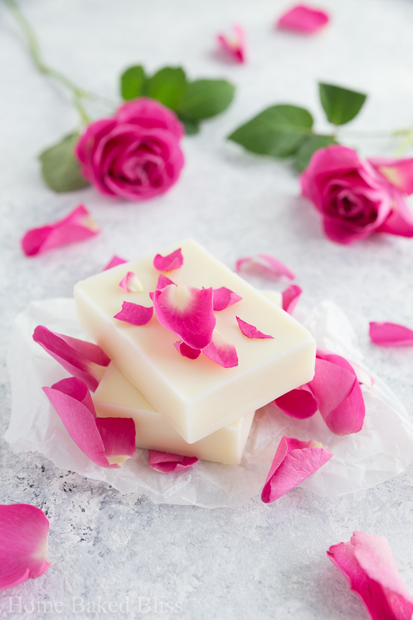 Easy diy rose lotion bars that are incredibly hydrating and suited for sensitive skin. Made with Shea butter and rose essential oil. Makes a gorgeous gift!