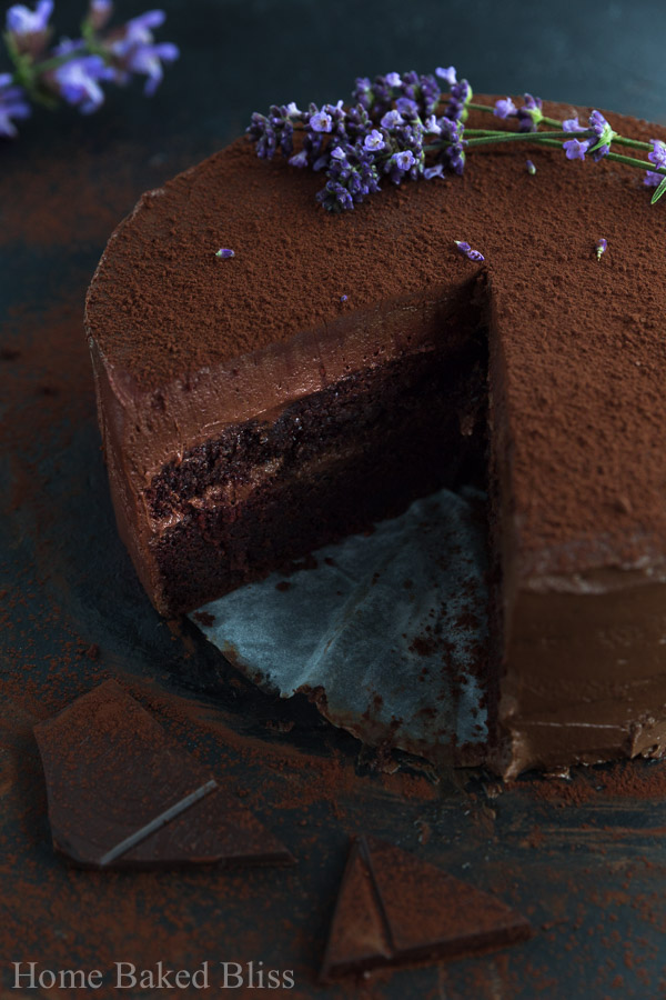A sneak peek inside the chocolate cake showing the layers of chocolate frosting.