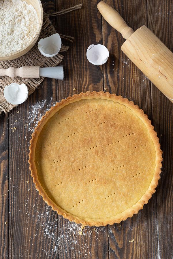 A golden brown sweet tart crust (pâte sucrée).