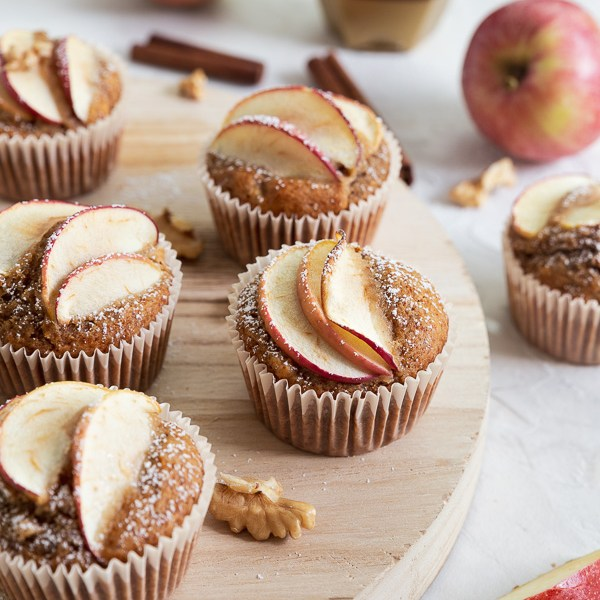 A closeup of apple walnut muffins sweetened with honey and garnished with apple slices