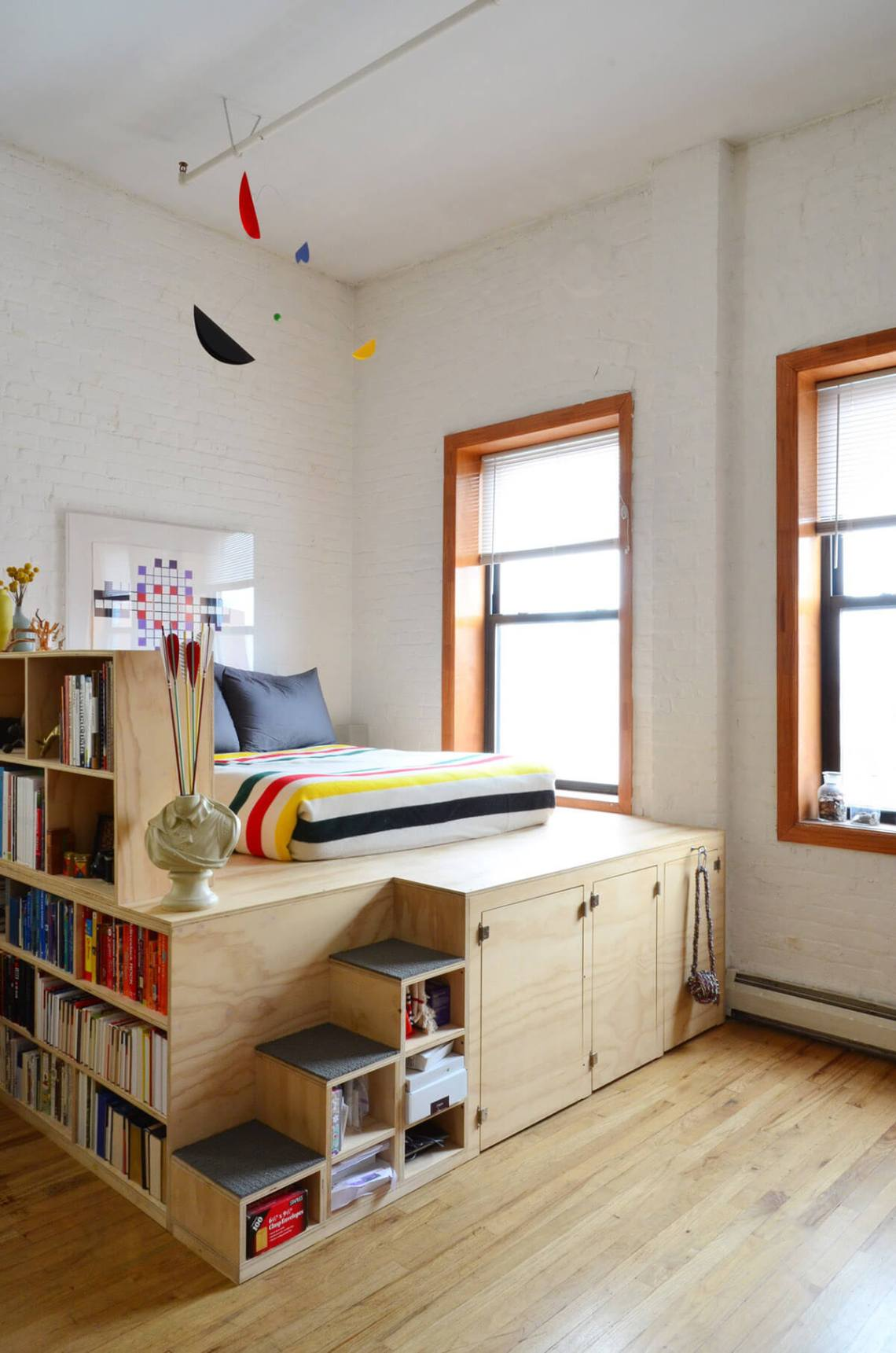 An Elevated Bed with Shelving and Storage — Homebnc