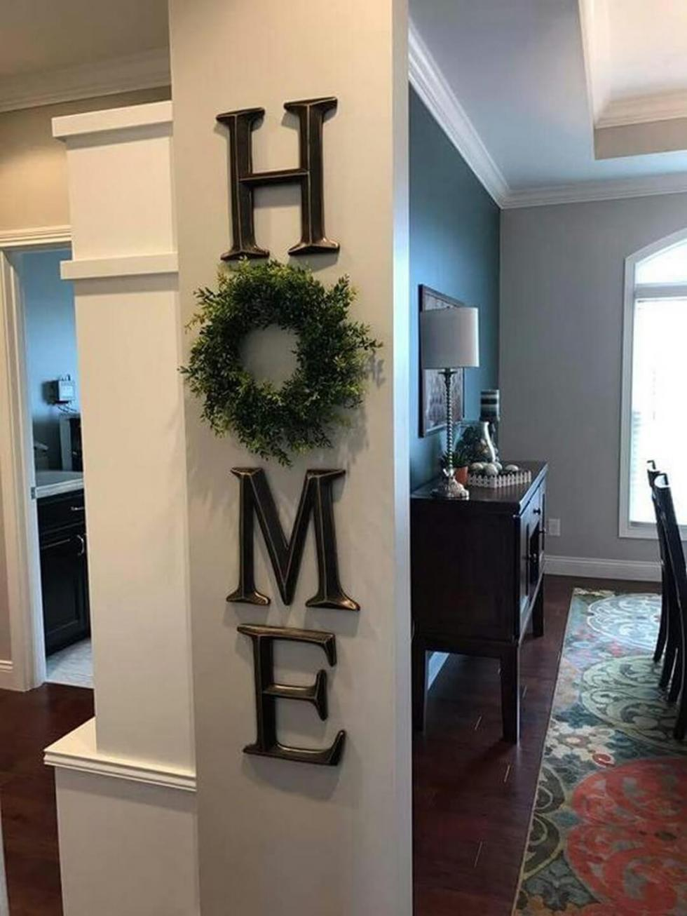 country wall decor with signs and wreath mix