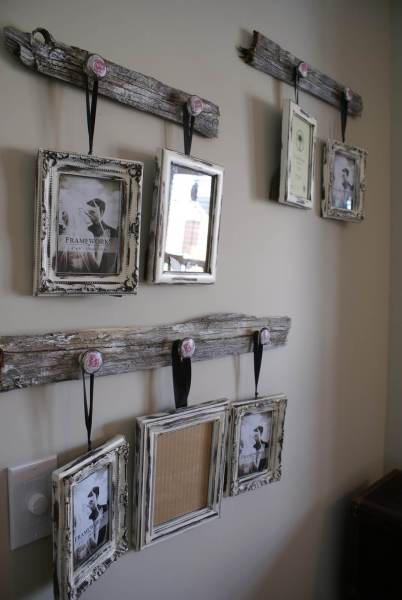 33 Best Rustic Living Room Wall Decor Ideas and Designs for 2018 Distressed Frames Hanging from Reclaimed Wood
