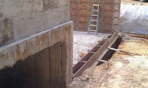 frost wall, concrete foundation wall, foundation waterproofing,form-a-drain, form a drain, concrete brick ledge, concrete forms, foundation walkout wall