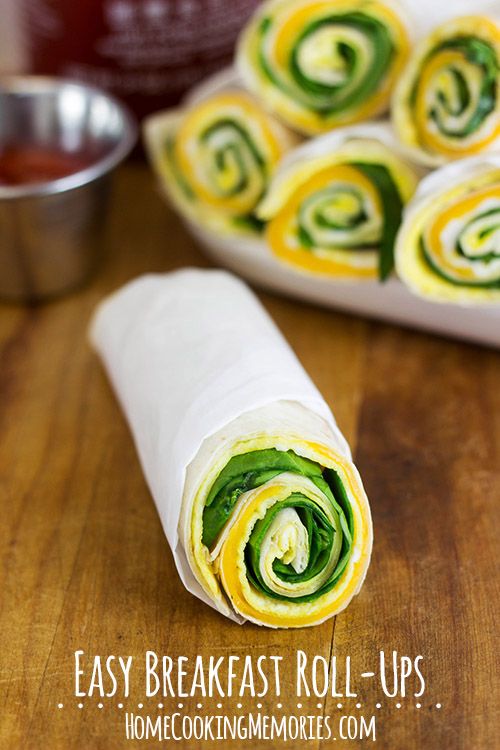 Easy Breakfast Roll-Ups -- a quick, on-the-go breakfast idea for busy mornings. Inspired by breakfast burritos, but the egg is cooked flat like an omelet, instead of scrambled. Less mess because small egg pieces don't fall out!