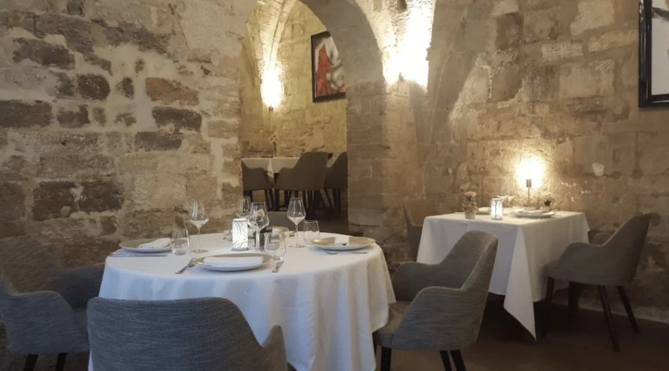 luxury restaurant stone walls arches table and chairs