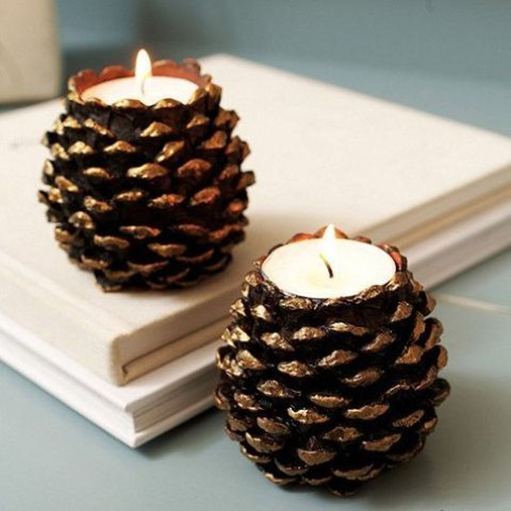 Creative DIY Christmas Candle Holders Ideas To Makes Your Room More Cheerful 19