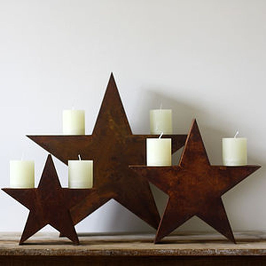 Creative DIY Christmas Candle Holders Ideas To Makes Your Room More Cheerful 26