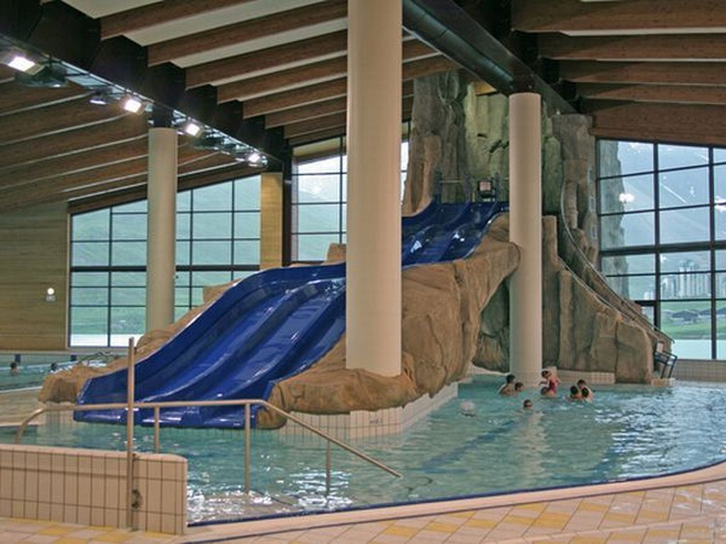 20 Awesome Indoor Swimming Pool Designs With Slide