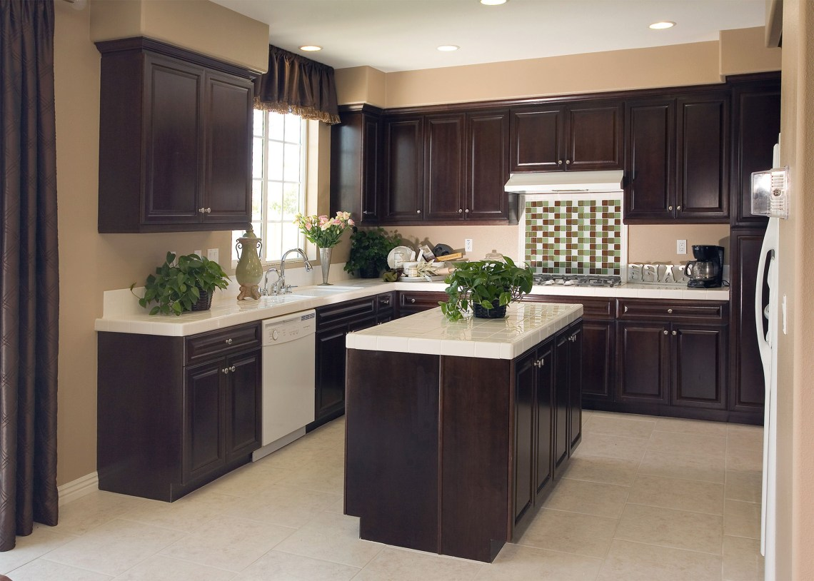 Amazing Dark Wood Cabinets With White Countertop As Well