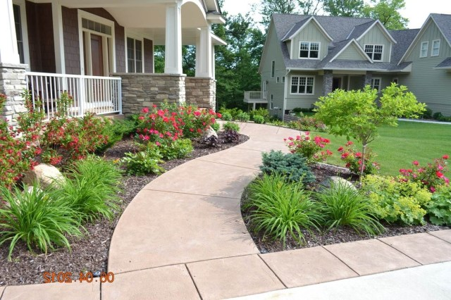 Beautiful Example Of Curved Sidewalk And Large Planting